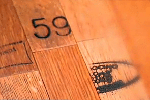 Reclaimed Wine Barrel Flooring with the Insignia and Vineyard Label